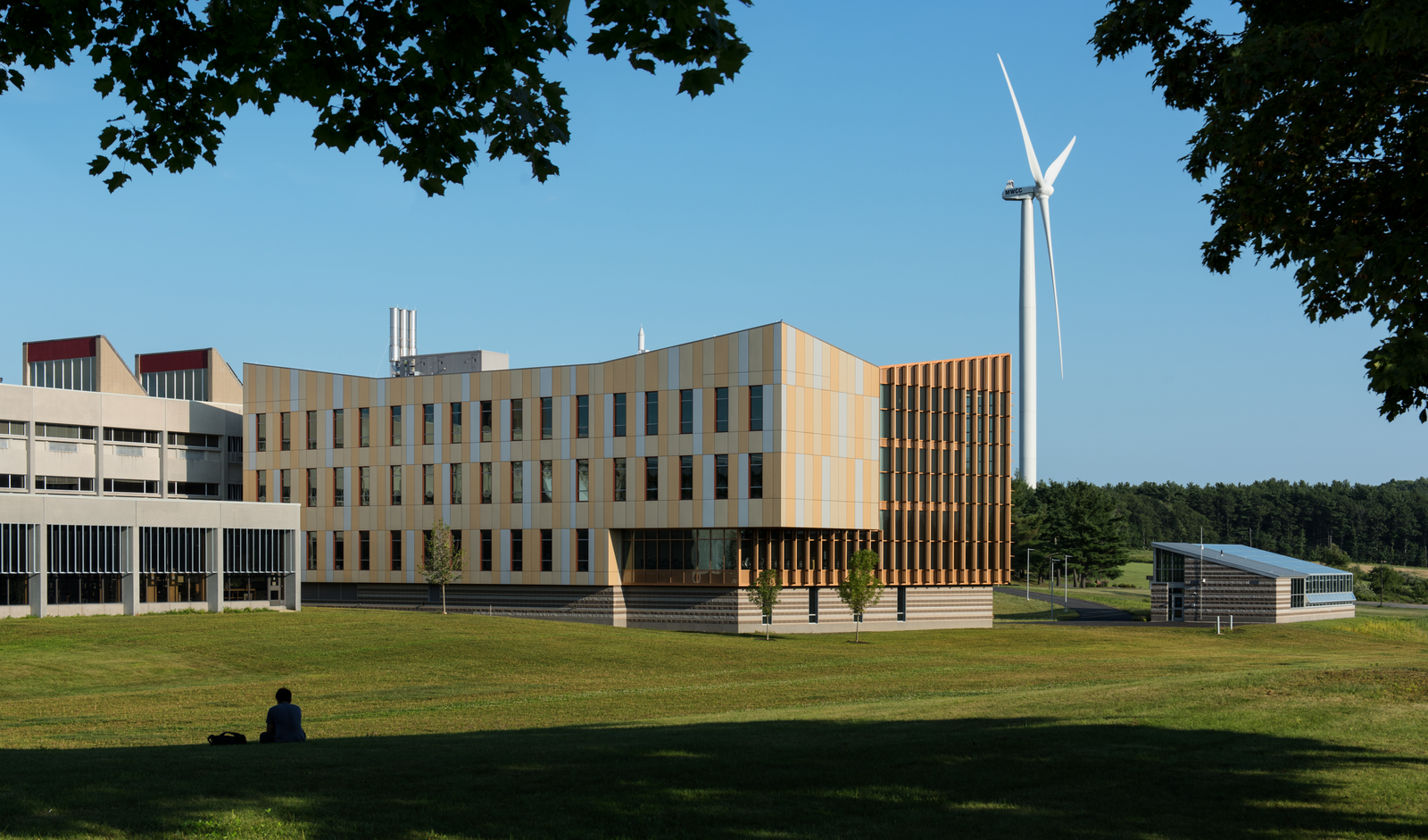 Front view of the Gardner campus with windmill during summer