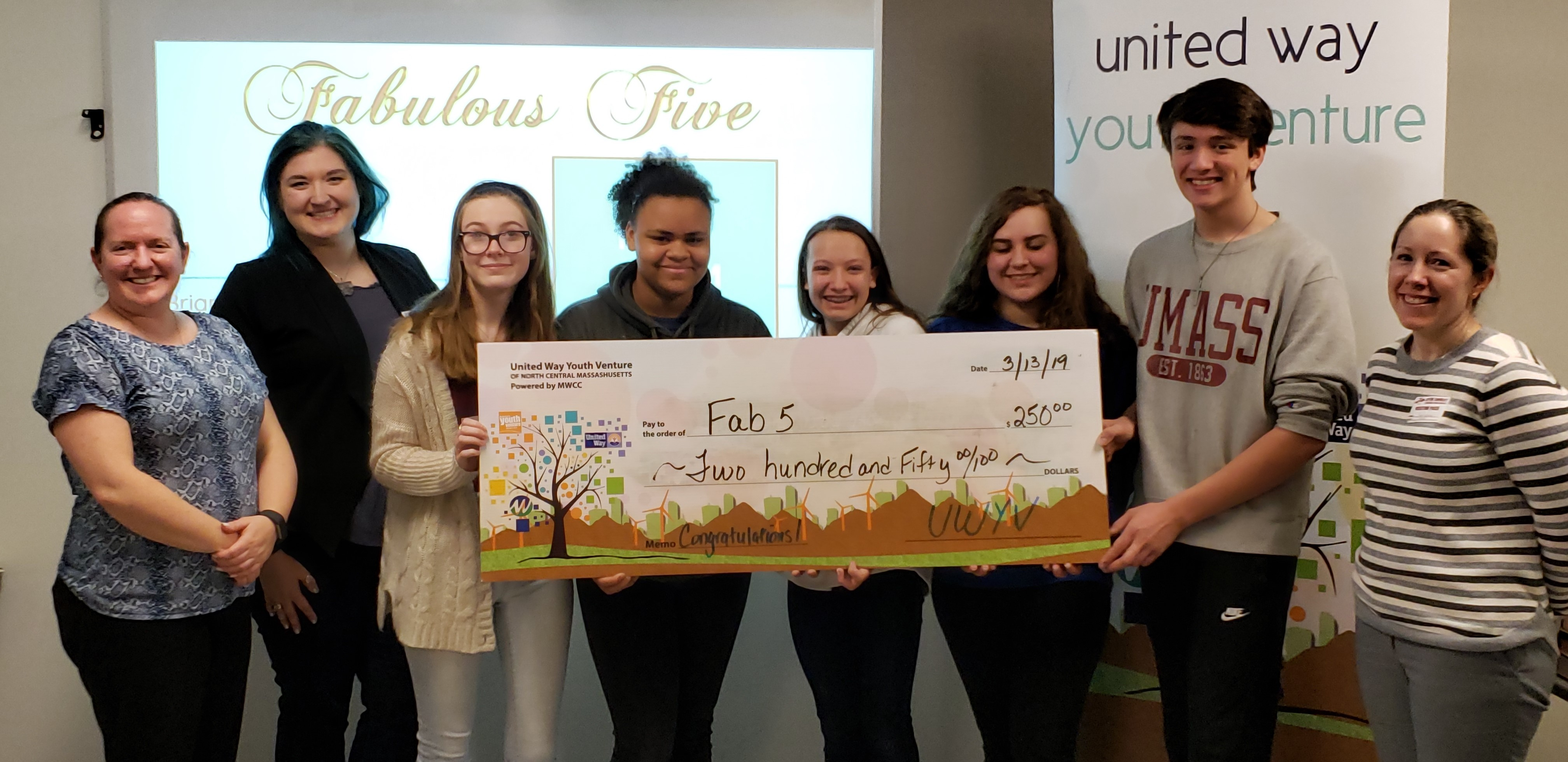 The Venture Team Fab 5 holding a big check for $250