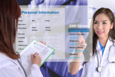 hand touching display of electronic medical record